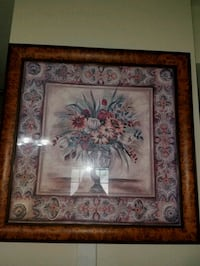 brown wooden framed painting of flowers 52 km