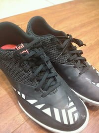 pair of black Adidas cleats Milton