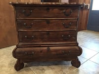 brown wooden 3-drawer chest with cabriole leg