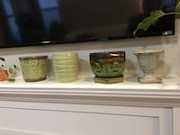 4 clay planters in shades of green