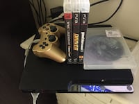 black Sony PS3 slim console with controller and game cases Salinas, 93906