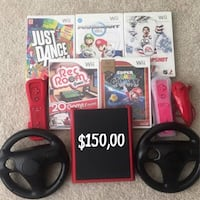 red Nintendo Wii console with controller and game cases Vancouver, V5R 6C9
