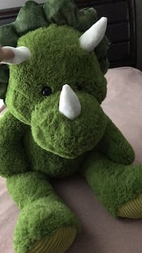 Green and white bear plush toy
