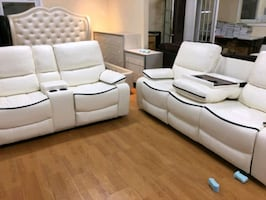 New in box off white faux leather reclining set