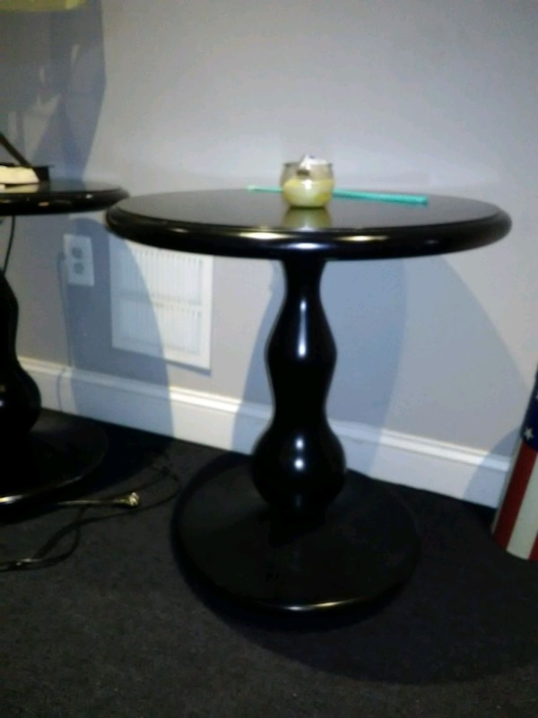 All black round hard wood table  1