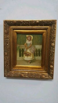 brown wooden framed painting of woman Aurora