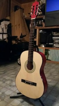 brown and black classical guitar Houston, 77091