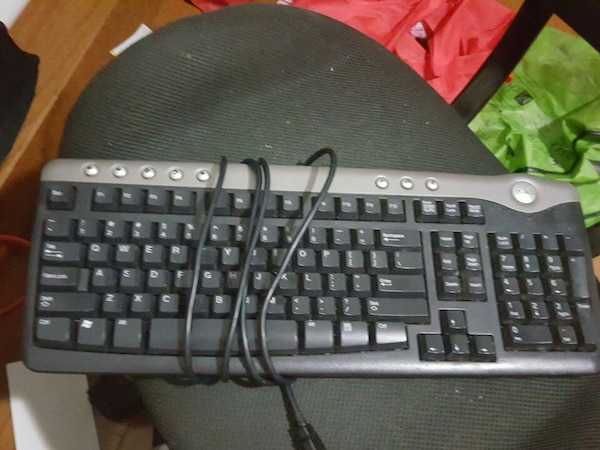grey-and-black dell corded computer keyboard