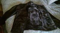 Brown leather jacket with fur inside like new