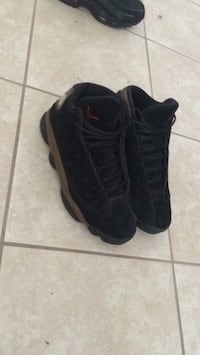 pair of black Air Jordan 13's Shalimar, 32579