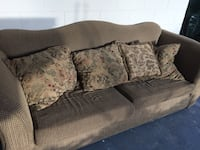 brown and black floral fabric loveseat 747 mi