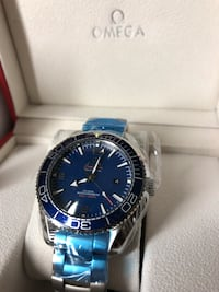 round blue Rolex analog watch with silver link bracelet Montréal, H4H 2T3