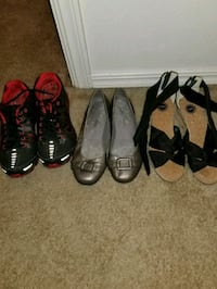 three pairs of black and brown leather shoes