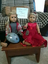 2 american girl dolls & a ton of non brand accessories & extra doll.