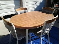 round brown wooden table with four chairs dining set 2347 mi