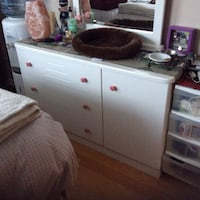 White dresser and large mirror.