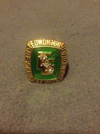 Green and gold-colored championship ring Edmonton, T6L 5C8