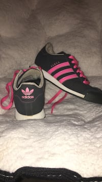 pair of black-and-pink Adidas Samoa sneakers