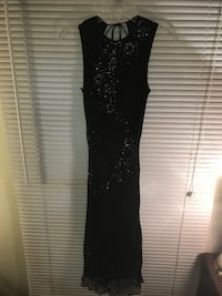 Long beaded dress low in back. Mount Pleasant, 28124