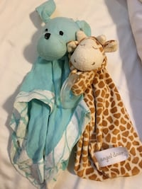 two brown and teal animal blankets Calgary, T3B 2R4
