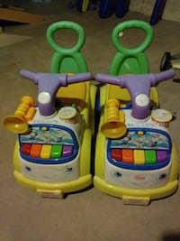 two yellow-green-and-purple ride-on car toys