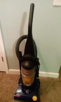 black and brown upright vacuum cleaner
