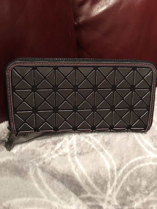b380e7cc067e Used Women s magical black leather wristlet it changes color by heat for  sale in Laval - letgo