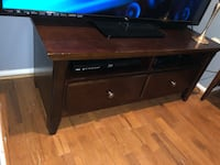 brown wooden TV stand with flat screen television Manassas, 20110
