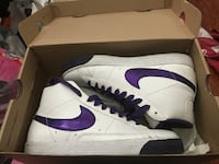pair of white-and-purple Nike sneakers