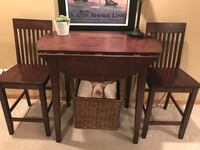 "Mahogany pub table and chairs in very good condition, rarely used  originally paid $250.  Selling both table and two chairs for 80.00 , table sides fold out to 39"" Orland Park, 60467"