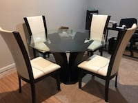 rectangular glass-top table with four chairs Dunn Loring, 22027