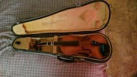 brown violin with bow in case St. Louis, 63118