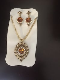 gold-colored and red gemstone pendant necklace Calgary, T3J