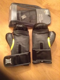 black-and-gray Everlast boxing gloves