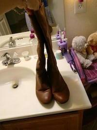 Brown leather boots knee high Las Vegas