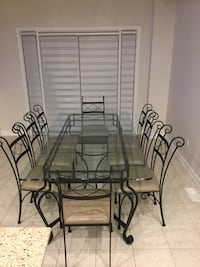Wrought iron glass table set with 8 chairs.  Bar stools available if interested Vaughan, L6A 2V7
