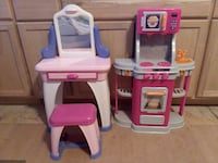 toddler's pink-and-white vanity table and pink-and-gray kitchen play set