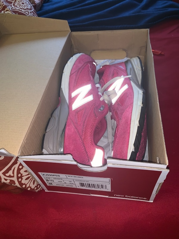 pair of red-and-white New Balance sneakers