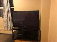 Black flat screen tv with black wooden tv stand Mississauga, L5J 2S8