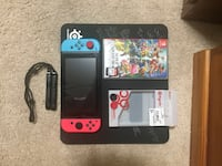 Nintendo Switch with Smash Bros and Extra Grips Basically New Penticton, V2A 4G8