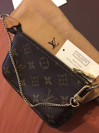 Brown monogrammed louis vuitton leather  New Westminster, V3L
