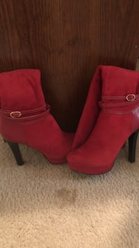pair of red suede knee boots