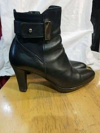 pair of black leather chunky heeled boots Calgary, T2B 2C7