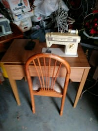 brown wooden table with chairs Fountain Inn