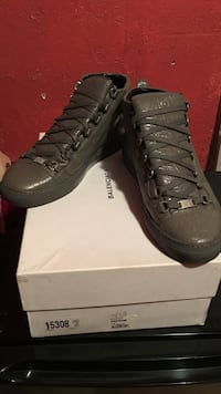pair of gray Balenciaga sneakers with box
