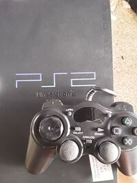 PS2 AND 9 GAMES WITH TWO CONTROLLERS  London, SE1