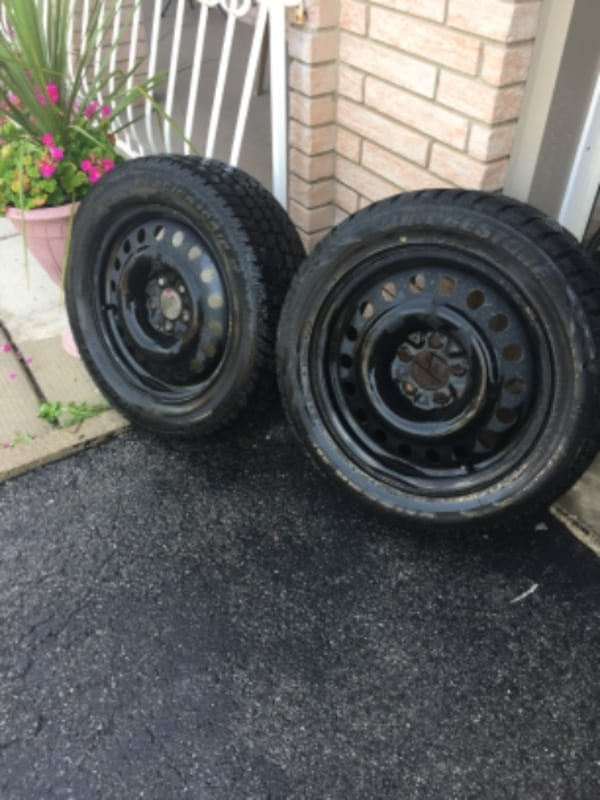4 - 17 inch Snow Tires on steel rims 2- blizzak and 2- glacier grip a51f5064-7342-49ed-a8d2-8ea3736b8ed8