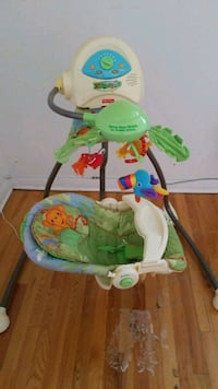 baby's white and green Fisher-Price bouncer Montréal, H1R 1N3