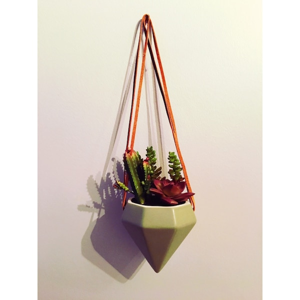 Hanging planter with faux plants