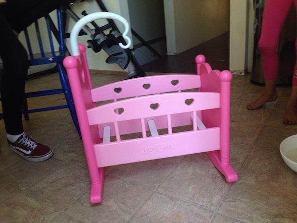 pink and white wooden bed frame